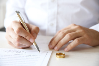 Man signing marriage contract, closeup
